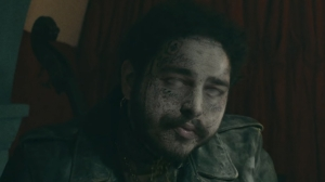 "Watch Post Malone Come Back From The Dead In New Music Video For ""Goodbyes"""